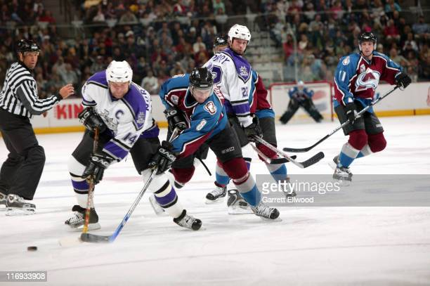 Mattias Norstrom of the Los Angeles Kings fights for the puck against Wojtek Wolski of the Colorado Avalanche on October 19, 2005 at Pepsi Center in...