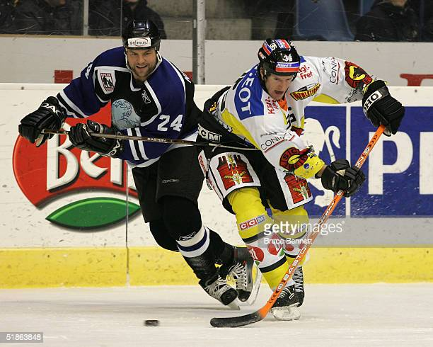 Mattias Norstrom of the Primus Worldstars gets the hook into Shean Donovan of SC Bern on December 15, 2004 at Bern Arena in Bern Switzerland. The...