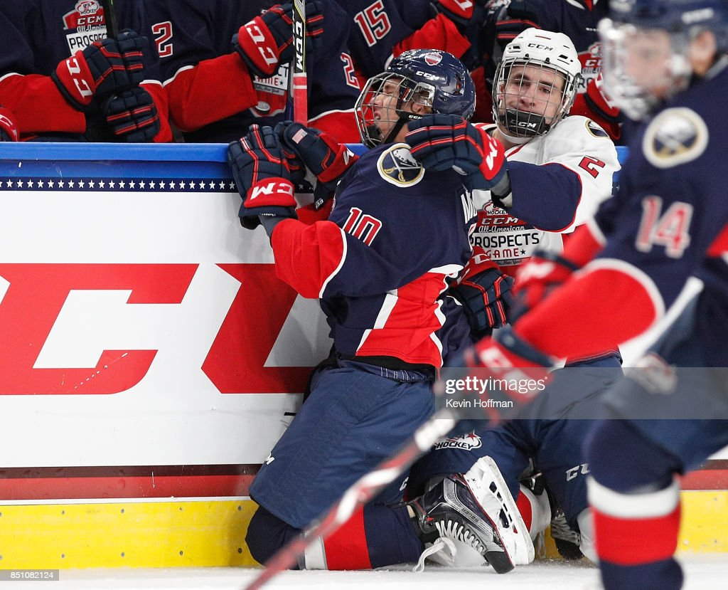 Mattias Samuelsson #2 of Team Chelios checks Blake McLaughlin #10 of Team Leetch in the second period during the CCM/USA Hockey All-American Prospects Game at the KeyBank Center on September 21, 2017 in Buffalo, New York.