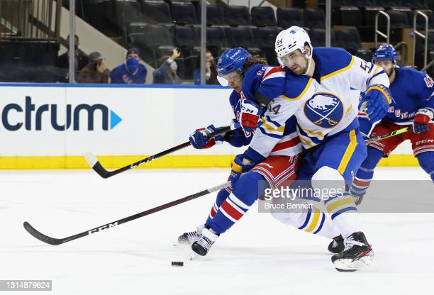 Mattias Samuelsson of the Buffalo Sabres slows down Artemi Panarin of the New York Rangers during the second period at Madison Square Garden on April...