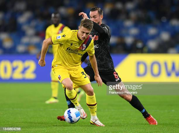 Mattias Svanberg of Bologna battles for possession with Fabian of SSC Napoli during the Serie A match between SSC Napoli and Bologna FC at Stadio...