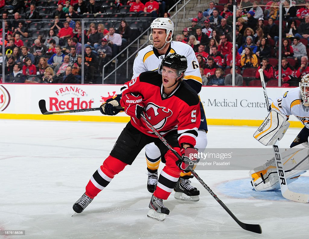 Mattias Tedenby #9 of the New Jersey Devils battles for position with Shea Weber #6 of the Nashville Predators during the second period on November 10, 2013 at the Prudential Center in Newark, New Jersey.