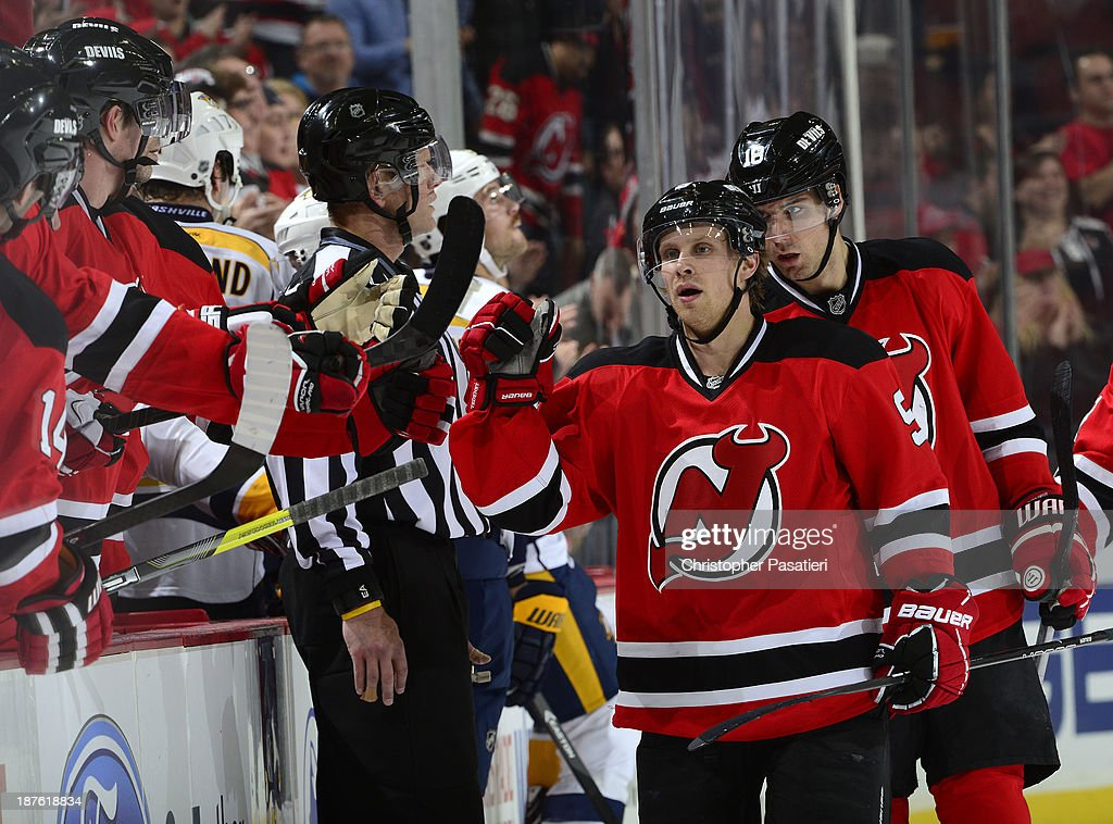 Mattias Tedenby #9 of the New Jersey Devils is congratulated after scoring a third period goal against the Nashville Predators on November 10, 2013 at the Prudential Center in Newark, New Jersey.