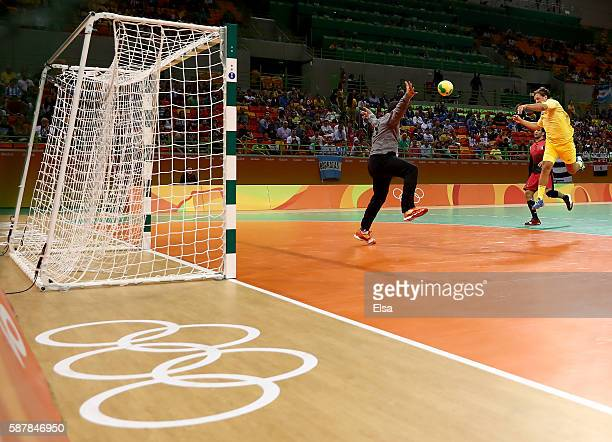 Mattias Zachrisson of Sweden gets the shot past Karim Hendawy of Egypt in the first half on Day 4 of the Rio 2016 Olympic Games at the Future Arena...