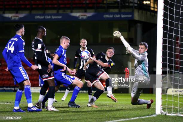 Mattie Pollock of Grimsby sees his shot go wide during the EFL Trophy match between Grimsby Town and Leicester City U21's at Blundell Park on...