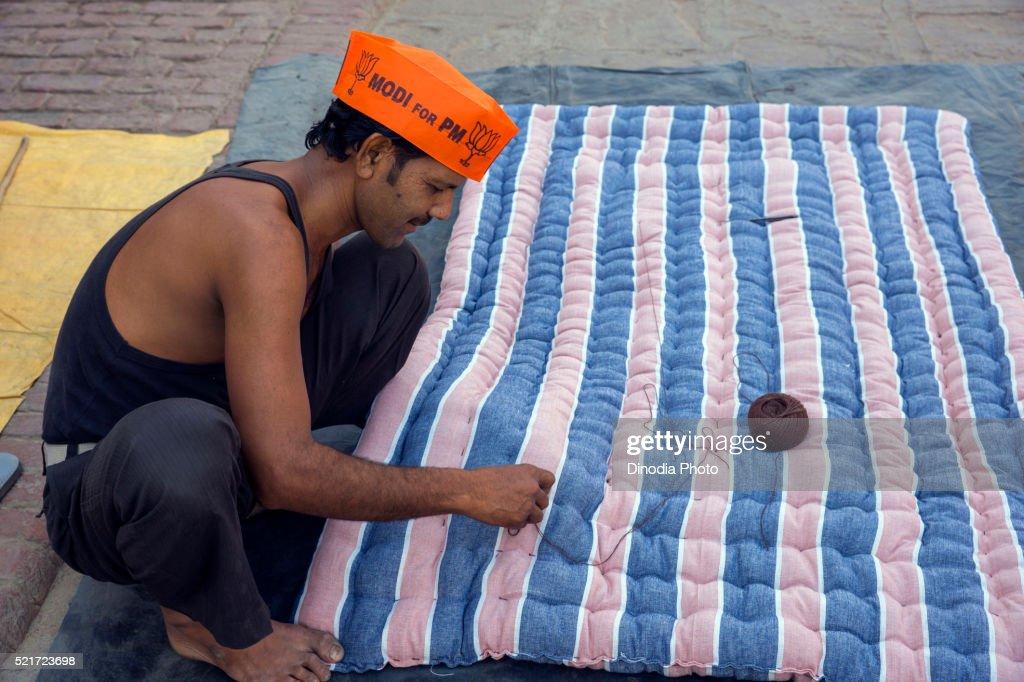 Mattress Maker Wearing Modi Cap, Varanasi, uttar pradesh, India, Asia : Stock Photo