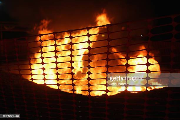 Mattresses and bed frames burn as Doctors Without Borders staff dismantle much of the Ebola Treatment Unit on January 31 2015 in Paynesville Liberia...