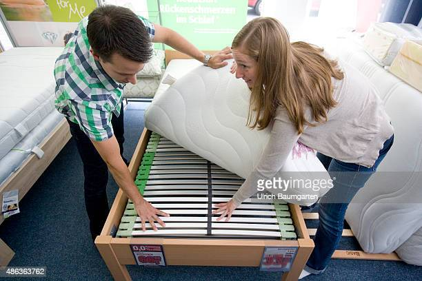 Mattresses and bed purchase Youing couple appraised slats and mattress