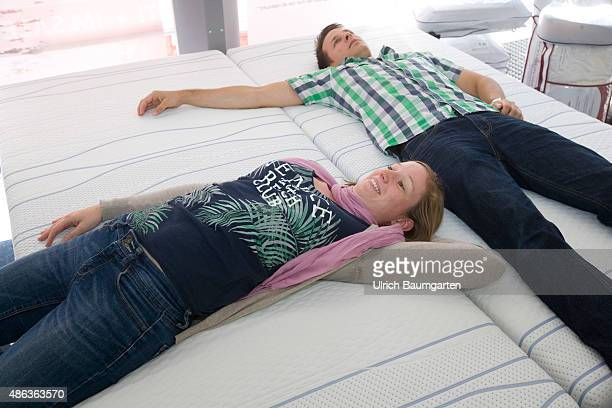 Mattresses and bed purchase Young couple at mattress test