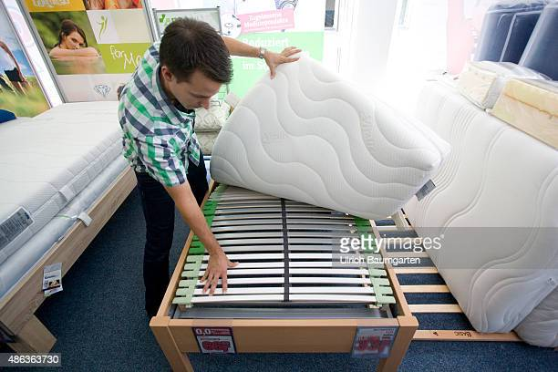 Mattresses and bed purchase Young man appraised slats and mattress