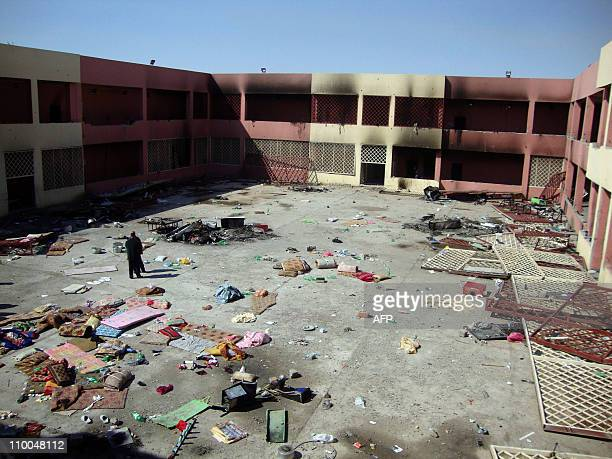 Mattresses and other items are strewn in the court yard of a prison in the northern Iraqi city of Tikrit on March 14 following riots in which the...