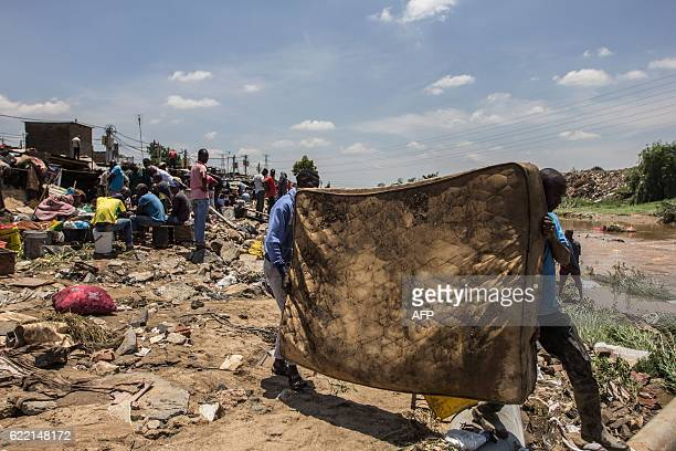 TOPSHOT Mattresses are salvaged and left out to dry on the banks of the Jukskei River in Alexandra Township after floodwaters ravaged over two...