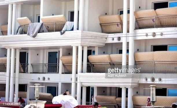 Mattresses of a hotel dry on balconies in Puri in the eastern Indian state of Odisha on May 10 2019 after the passage of cyclone Fani At least 42...