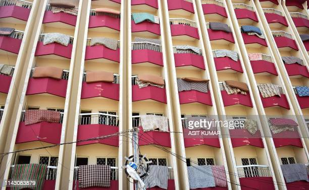 Mattresses of a hotel dry on balconies in Puri in the eastern Indian state of Odisha on May 11 2019 after the passage of cyclone Fani At least 42...