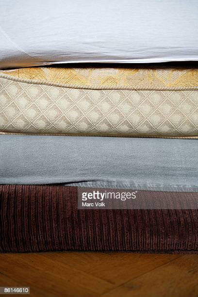 Mattresses stacked on top of each other
