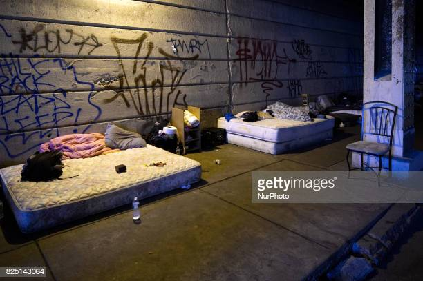 Mattresses under Emerald Street Bridge provide a make shift resting place for addicts in the Kensington section of Philadelphia PA on July 31 2017 A...