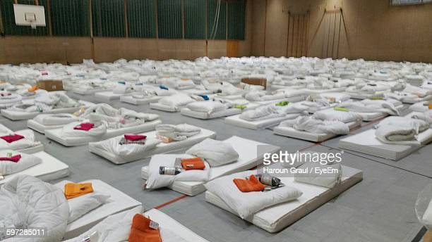 Mattresses With Pillows Arranged In Room