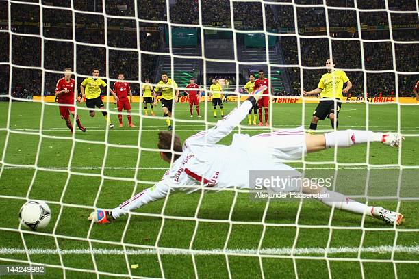 Matts Hummels of Dortmund scores the second team goal with a penalty against Manuel Neuer keeper of Muenchen during the DFB Cup final match between...