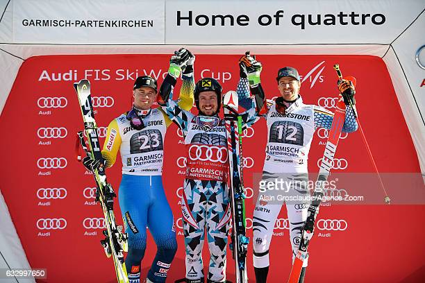 Matts Olsson of Sweden takes 2nd place Marcel Hirscher of Austria takes 1st place Stefan Luitz of Germany takes 3rd place during the Audi FIS Alpine...