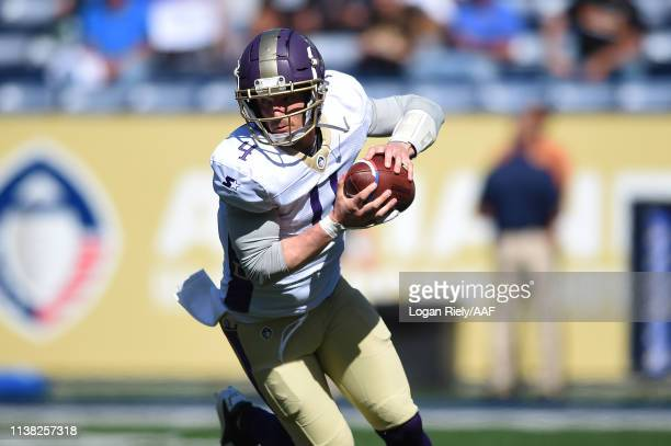 MattSimms of the Atlanta Legends looks to scramble against the Orlando Apollos in an Alliance of American Football game at Georgia State Stadium on...