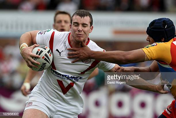 Matty Ashurst of St Helens is held by Ben JonesBishop during the Engage Super League match between St Helens and Harlequins RL at Knowsley Road on...