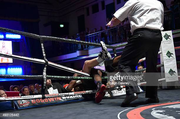 Matty Askin and Lawrence Bennett fall through the ropes bringing their bout to a end due to a technical draw in English Cruiserweight title fight at...