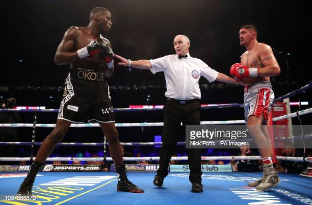 Matty Askin and Lawrence Okolie are separated by match referee Victor Loughlin at Wembley Stadium London