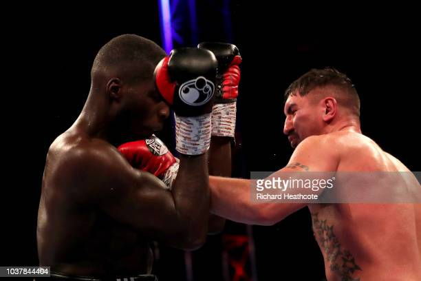 Matty Askin punches Lawrence Okolie during the British Cruiserweight Championship title fight between Matty Askin and Lawrence Okolie at Wembley...