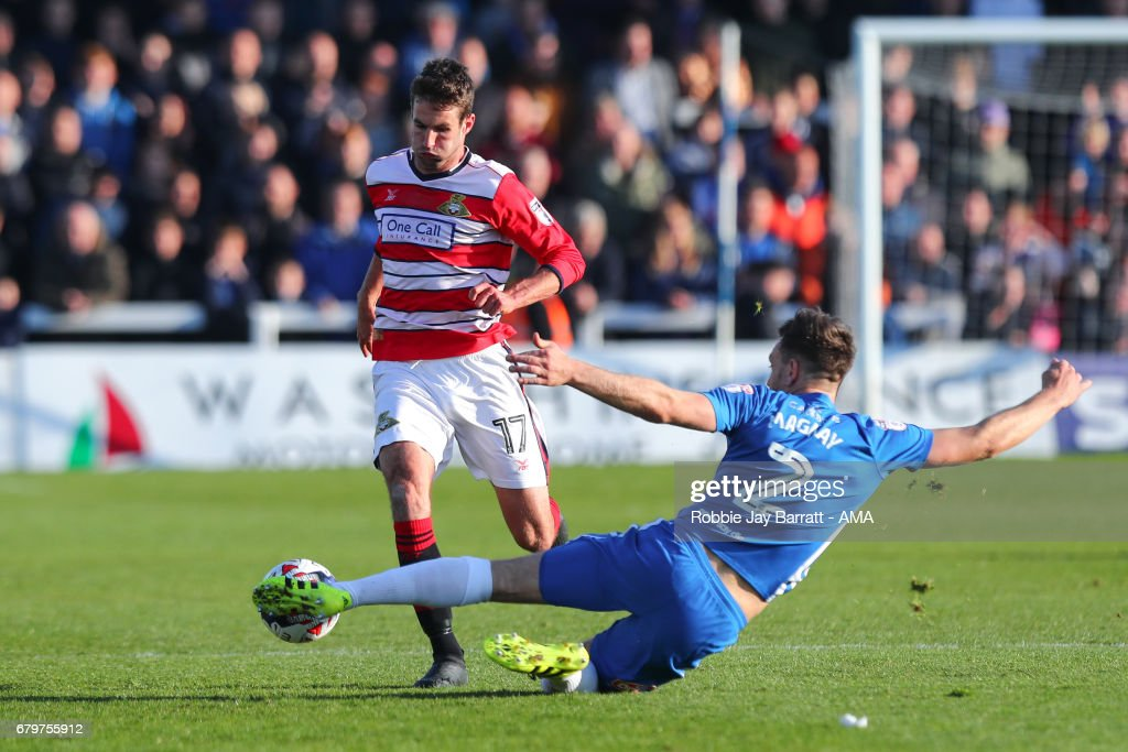 Matty Blair of Doncaster Rovers and Carl Magnay of Hartlepool United during the Sky Bet League Two match between Hartlepool United and Doncaster Rovers at Victoria Park on May 6, 2017 in Hartlepool, England.