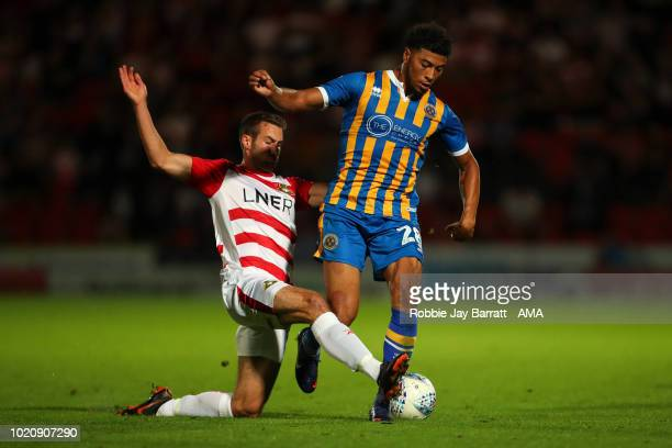 Matty Blair of Doncaster Rovers and Josh Laurent of Shrewsbury Town during the Sky Bet League One match between Doncaster Rovers and Shrewsbury Town...