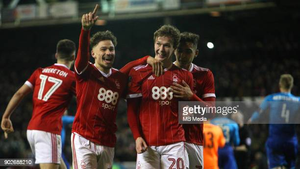 Matty Cash and Tyler Walker congratulate penalty goalscorer Kieron Dowell during The Emirates FA Cup Third Round match between Nottingham Forest and...