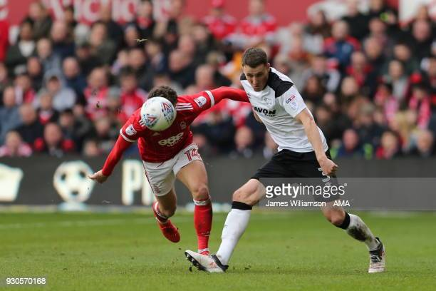 Matty Cash of Nottingham Forest and Craig Forsyth of Derby County during the Sky Bet Championship match between Nottingham Forest and Derby County at...