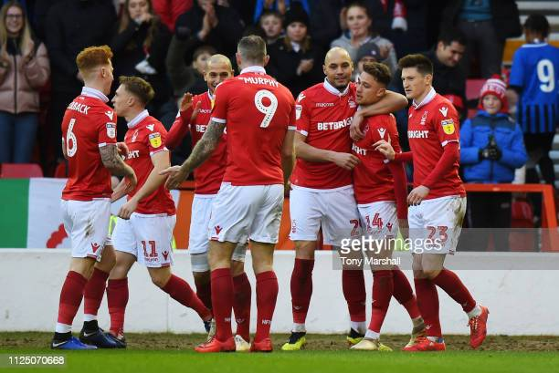 Matty Cash of Nottingham Forest celebrates after scoring his team's second goal with team mates during the Sky Bet Championship match between...
