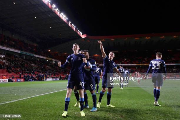 Matty Daly of Huddersfield Town celebrates after scoring the match winning goal during the Sky Bet Championship match between Charlton Athletic and...