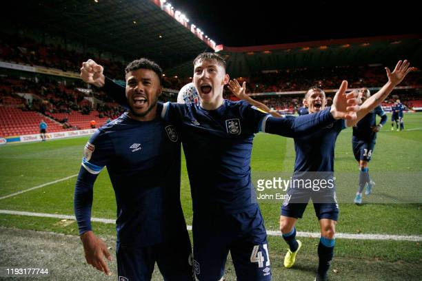 Matty Daly of Huddersfield Town celebrates his winning goal with team mates Elias Kachunga and Jonathan Hogg during the Sky Bet Championship match...