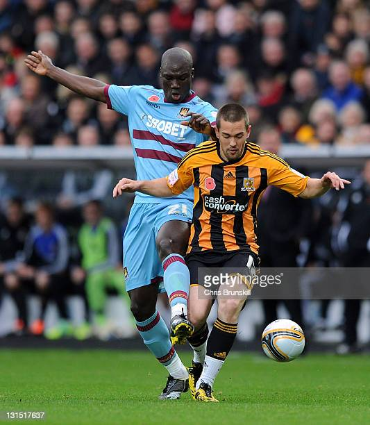Matty Fryatt of Hull City competes with Papa Bouba Diop of West Ham United during the npower Championship match between Hull City and West Ham United...