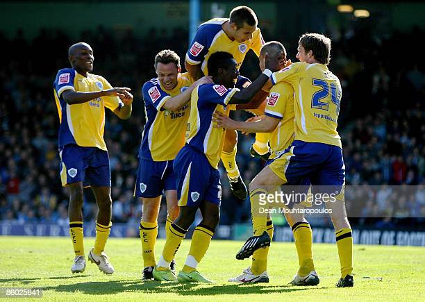 Matty Fryatt of Leicester celebrates with team mates after scoring his second goal the 20 goal during the CocaCola Football League One match between...