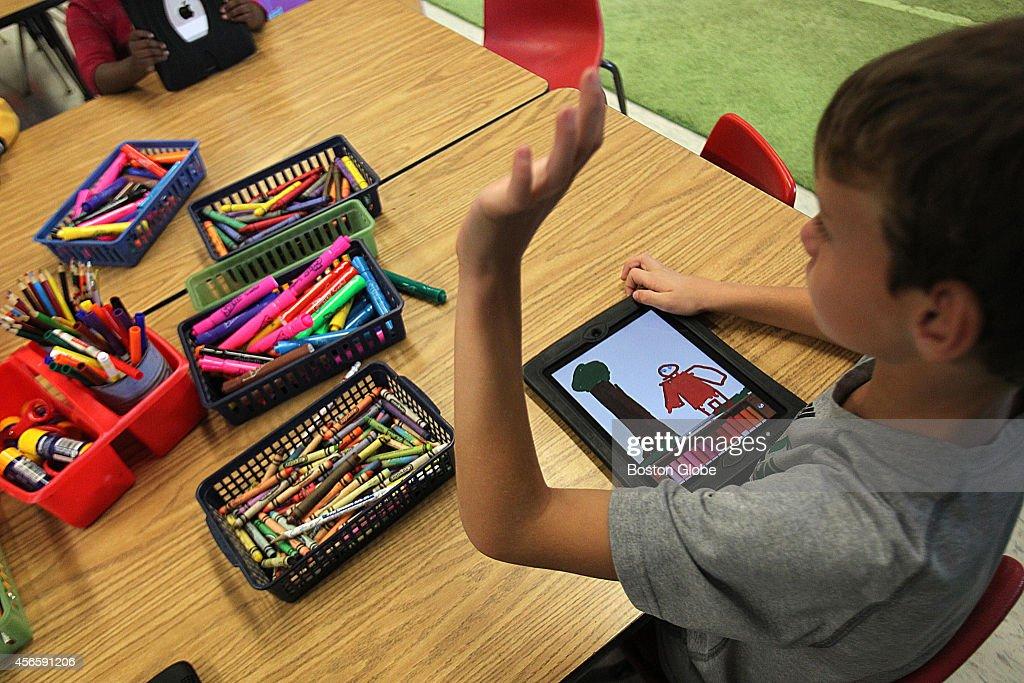 Matty Gray on his iPad at the Francis Wyman Elementary School in Burlington, Mass.
