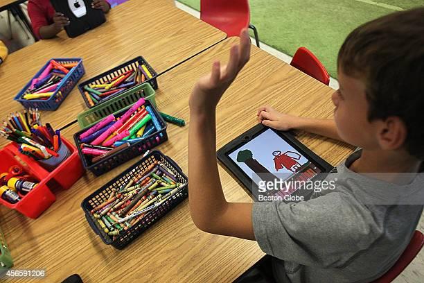Matty Gray on his iPad at the Francis Wyman Elementary School in Burlington Mass