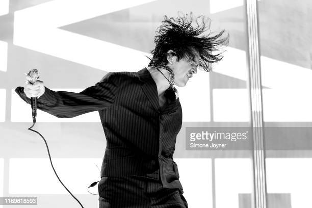 Matty Healy of The 1975 performs live on the Main Stage during day one of Reading Festival 2019 at Richfield Avenue on August 23, 2019 in Reading,...