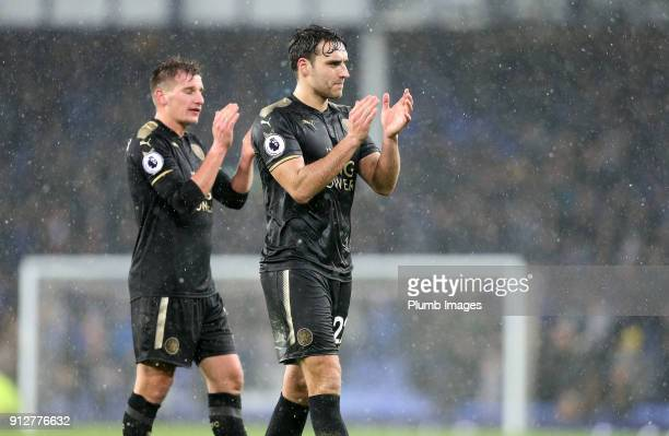 Matty James and Marc Albrighton of Leicester City applaud the travelling fans after the Premier League match between Everton and Leicester City at...