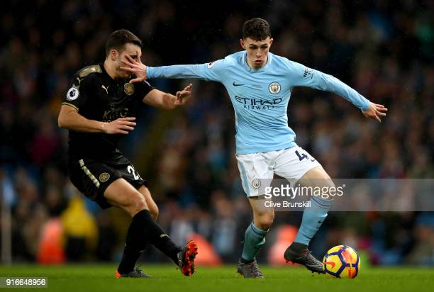 Matty James of Leicester City and Phil Foden of Manchester City battle for the ball during the Premier League match between Manchester City and...