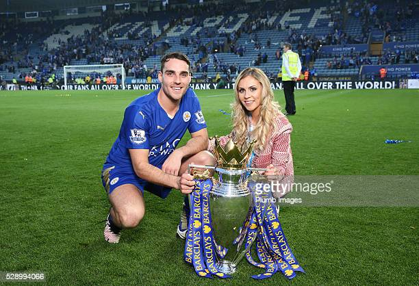 Matty James of Leicester City celebrates with the Premier League trophy after the Barclays Premier League match between Leicester City and Everton at...