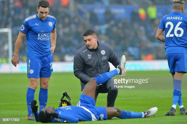 Matty James of Leicester City checks on Daniel Amartey of Leicester City as he receives treatment before having to go off injured during the Premier...
