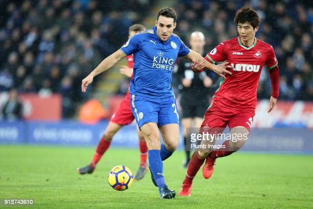 Matty James of Leicester City in action with Ki SungYueng of Swansea City during the Premier League match between Leicester City and Swansea City at...