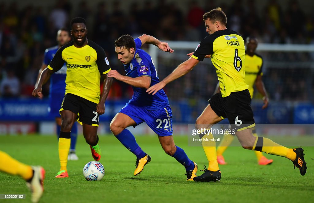 Matty James of Leicester City runs past Ben Turner of Burton Albion during the Pre-Season Friendly match between Burton Albion v Leicester City at Pirelli Stadium on August 1, 2017 in Burton-upon-Trent, England.