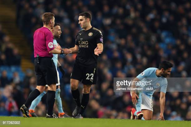 Matty James of Leicester City speaks to match referee Michael Jones during the Premier League match between Manchester City and Leicester City at...