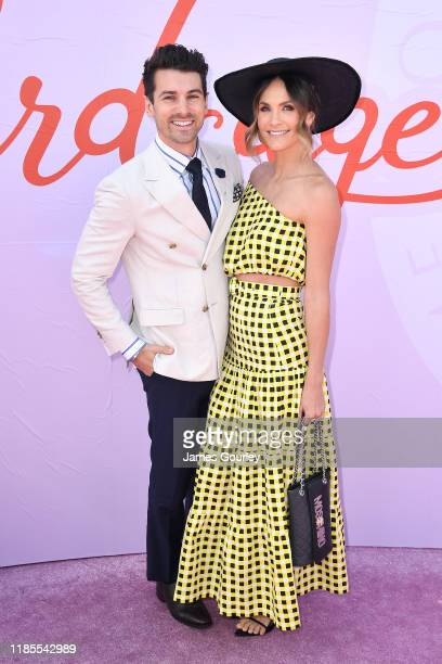 Matty Johnson and Laura Byrne attend Melbourne Cup Day at Flemington Racecourse on November 05 2019 in Melbourne Australia
