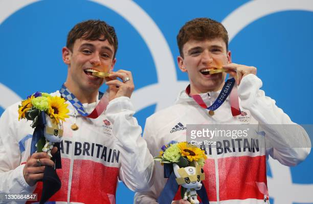 Matty Lee and Thomas Daley of Team Great Britain pose with their gold medals during the medal presentation for the Men's Synchronised 10m Platform...