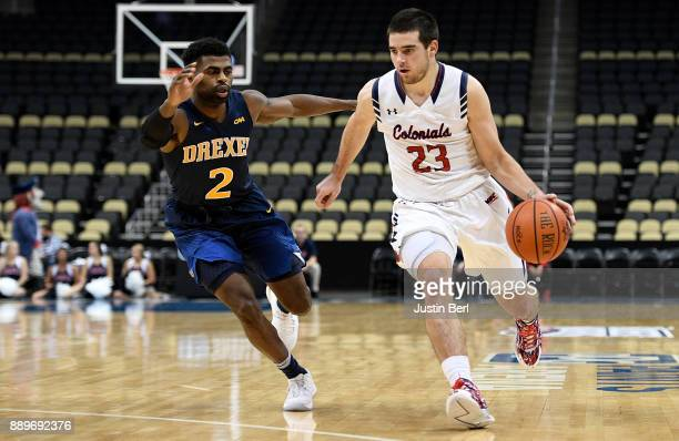 Matty McConnell of the Robert Morris Colonials dribbles against Tramaine Isabell of the Drexel Dragons in the second half during the game at PPG...